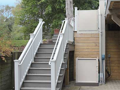 Vertical Platform Lift outside by stairs to house