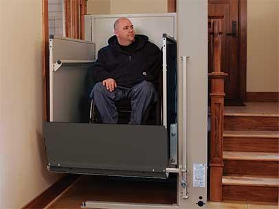 Man in wheelchair in folding ramp